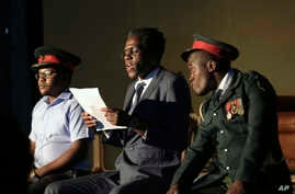 In this photo taken March, 28, 2018, actor Khetani Banda, playing former Zimbabwean president Robert Mugabe, center, reads a speech flanked by army generals during a play dramatizing the events leading to his resignation, in Harare, Zimbabwe.