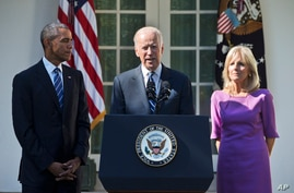 Vice President Joe Biden, accompanied by his wife Jill and President Barack Obama, announces that he will not run for the presidential nomination, Oct. 21, 2015, in the Rose Garden of the White House in Washington.