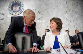 Sen. Angus King, I-Maine, left, speaks with Sen. Susan Collins, R-Maine, right, before a Senate Intelligence Committee hearing on 'Policy Response to Russian Interference in the 2016 U.S. Elections' on Capitol Hill, June 20, 2018, in Washington.