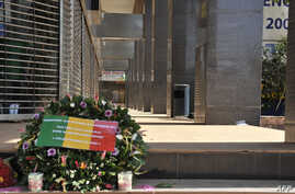 Flowers have been laid at the entrance the Radisson Blu hotel in Bamako on Nov. 24, 2015, in tribute to the victims four days after the deadly terrorist attack that left 27 people killed.