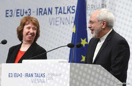 European Union foreign policy chief Catherine Ashton (L) and Iranian Foreign Minister Mohammad Javad Zarif share a laugh during a press statement after a conference in Vienna, Feb. 20, 2014.