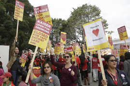 Registered nurses and supporters protest outside a Kaiser Permanente facility in San Francisco against of lack of training in combating Ebola, Nov. 11, 2014.