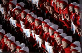 North Korean cheerleaders sing in unison before the opening ceremony of the 2018 Winter Olympics in Pyeongchang, South Korea, Friday, Feb. 9, 2018.