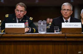 Gen. Robert Abrams, left, and Navy Vice Adm. Craig Faller, look to the dais as they testify before the Senate Armed Services Committee on Capitol Hill in Washington, Sept. 25, 2018.