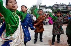 Tibetan boys dance during celebrations to mark the 82nd birthday of their spiritual leader the Dalai Lama at a Tibetan camp in Lalitpur, Nepal, July 6, 2017.