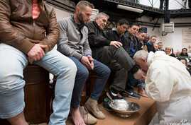 Pope Francis washes the feet of inmates during his visit to the Regina Coeli detention center in Rome, March 29, 2018. During his Holy Thursday visit, Francis stressed that a pope must serve society's marginalized and give them hope.