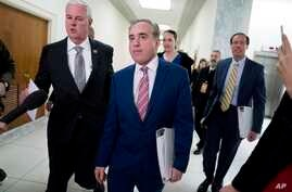 Rep. Steve Womack, R-Ark. (L) greets Veterans Affairs Secretary David Shulkin (C), as he arrives for a House Appropriations subcommittee hearing on Capitol Hill in Washington, March 15, 2018.