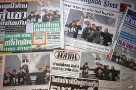 FILE - Front pages of Thai newspapers in Bangkok.