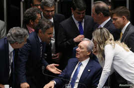 President of Brazil's Supreme Court, Ricardo Lewandowski (seated) speaks with senators during a discussion before the Senate votes on whether suspended President Dilma Rousseff should stand trial for impeachment, in Brasilia, Brazil, August 9, 2016.