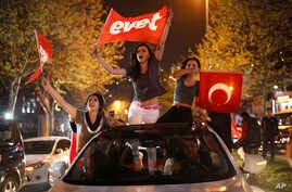 "Supporters of the ""Yes"" vote, wave flags during celebrations in Istanbul, on Sunday, April 16, 2017."