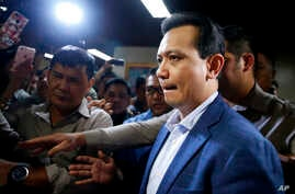 Philippine opposition Senator Antonio Trillanes is escorted to his room following a hastily-called news conference at the Philippines Senate, Sept. 4, 2018, in suburban Pasay city, south of Manila, Philippines.
