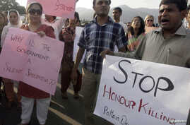"""FILE - Human rights activists in Islamabad stage a rally against """"honor killings."""""""
