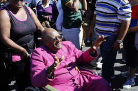 FILE - Archbishop Emeritus Desmond Tutu waves to well-wishers in Cape Town in a April 19, 2014, photo.