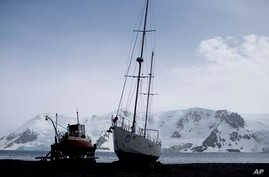 FILE - Most visitors arrive on the Antarctic Peninsula, including the beach at Bahia Almirantazgo, where boats sit, Jan. 27, 2015. The next most popular destination is the Ross Sea on the opposite side of the continent.