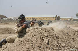 Iraqi soldiers train with members of the U.S. Army 3rd Brigade Combat Team, 82nd Airborne Division, at Camp Taji, Iraq, in this U.S. Army photo released June 2, 2015.