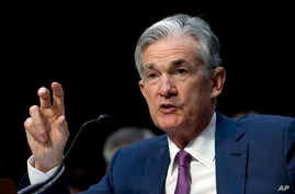 """Federal Reserve Board Chair Jerome Powell testifies before the Senate Committee on Banking, Housing and Urban Affairs on """"The Semiannual Monetary Policy Report to the Congress,"""" at Capitol Hill in Washington, July 17, 2018."""
