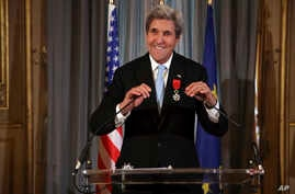 """U.S. Secretary of State John Kerry smiles before delivering his speech after being awarded of the Legion d'Honneur medal, at the Quai d'Orsay, in Paris, Dec. 10, 2016. The Foreign Ministry said he earned the distinction """"for his contribution of the"""