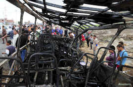 Relatives of students and members of the public look at the wreckage of a school bus after it crashed in Damanhur November 5, 2014.