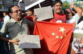 Indian citizens shout anti-Chinese slogans during a protest to boycott Chinese products in Ahmedabad on May 3, 2013.