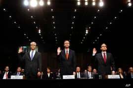 FILE - In this Wednesday, Nov. 1, 2017, file photo, from left, Facebook's General Counsel Colin Stretch, Twitter's Acting General Counsel Sean Edgett, and Google's Senior Vice President and General Counsel Kent Walker, are sworn in for a Senate Intel