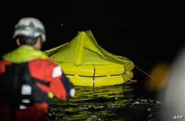 One of two life rafts dropped by an Italian navy airplane to survivors of an inflatable boat that capsized is pictured from the Dutch-flagged rescue vessel Sea-Watch 3 early on Jan. 19, 2019, off Libya's coast about 70 nautical miles north east of Tr