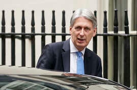 FILE - Britain's Chancellor of the Exchequer Philip Hammond leaves 11 Downing Street, in London, Dec. 10, 2018.