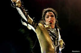 FILE - 'King of Pop' Michael Jackson performs during concert in Vienna, Austria, July 2, 1997.