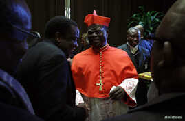 FILE - Cardinal Laurent Monsengwo of the Democratic Republic of Congo receives guests in the Paul VI hall at the Vatican, Nov. 20, 2010.