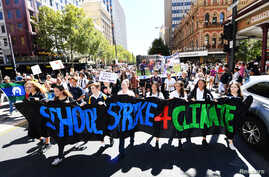 School students march up King William Street after attending the global #ClimateStrike rally at South Australia's Parliament House in Adelaide, Australia, March 15, 2019.