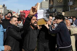 Mourners carry a coffin of prominent social activist Wissam al-Ghrawi in Basra, Iraq, Nov. 18, 2018.