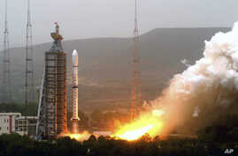 FILE - Photo released by China's Xinhua News Agency shows Olympic weather forecasting satellite, the Fengyun-3 (FY-3), launched on a Long March-4C carrier rocket from the Taiyuan Satellite Launch Center in northern Shanxi Province.