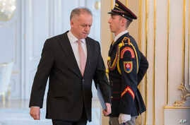 Slovakian President Andrej Kiska arrives at the press conference at Presidential Palace in Bratislava, March, 20, 2018. Slovakia's president has rejected a proposal for a new government following a crisis triggered by the killing of a journalist and ...