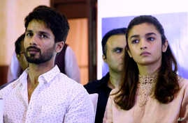 "Bollywood film ""Udta Punjab,"" or ""Flying Punjab"" actors Shahid Kapoor, left, and Alia Bhatt listen to a question during a press conference, in Mumbai, India, Wednesday, June 8, 2016."