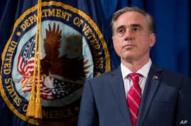 "Veterans Affairs Secretary David Shulkin appears at a ceremony where President Donald Trump signs an Executive Order on ""Improving Accountability and Whistleblower Protection"" at the Department of Veterans Affairs, April 27, 2017, in Washington."