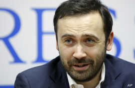 Ilya Ponomaryov, a lawmaker who is one of the leaders of the Left Front opposition movement, speaks to the media in Moscow, Russia, Friday, Dec. 9, 2011. Energized activists and anxious authorities are bracing for anti-government protests planned acr
