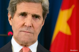 U.S. Secretary of State John Kerry pauses as he listens to a question during a news conference in Beijing, Feb. 14, 2014.