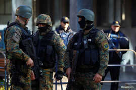 Heavily armed Macedonian police guard the premises of a court, during the final verdict for 37 people arrested and charged with terrorism-related offenses for clashes with Macedonian police in 2015 in Kumanovo, in Skopje, Macedonia, Nov. 2, 2017.