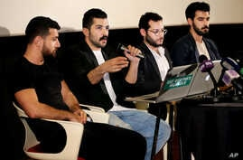 "Lebanese Hamed Sinno, second left, lead singer and song writer of the Lebanese group Mashrou' Leila or ""Leila's Project"" band, speaks during a press conference with his band musicians, in Beirut, Lebanon, Thursday, April 28, 2016."