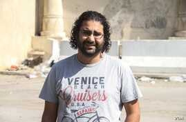 Egyptian pro-democracy activist Alla Abdel Fattah was barred from the court session where he was sentenced to 15 years in prison for protesting a restrictive protest law, Cairo, June 11, 2014. (Hamada Elrasam/VOA)