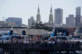 FILE - Spectators at Pier 39 watch an America's Cup sailing event in San Francisco, Sept. 18, 2013. The FBI said Dec. 22, 2017, that it had found a martyrdom letter and several guns in the home of a former Marine who may have been planning a Christma