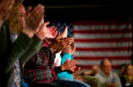 Supporters clap while listening to Democratic presidential candidate Sen. Bernie Sanders, at a campaign event in Maquoketa, Iowa, Jan. 23, 2016.