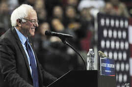 Democratic presidential candidate Bernie Sanders smiles as a bird lands on his podium during a campaign speech in Portland, Oregon, March 25, 2016.