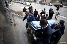 Pallbearers carry the casket of Quintonio LeGrier during his funeral in Chicago, Jan. 9, 2016. LeGrier was fatally shot by a Chicago police officer after allegedly swinging a baseball bat at him.