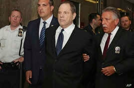 Harvey Weinstein is escorted in handcuffs to a courtroom in New York, Monday, July 9, 2018.