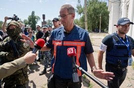 Peter Van Vilet, team leader of Holland's National Forensic Investigations Team speaks to media after inspecting a refrigerated train loaded with the bodies of passengers in Torez, eastern Ukraine, July 21, 2014.