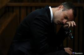 Oscar Pistorius attends his trial at the high court in Pretoria, South Africa, April 7, 2014.
