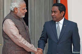 File - India's Prime Minister Narendra Modi (L) shakes hands with Maldives President Abdulla Yameen before the start of their bilateral meeting in New Delhi.