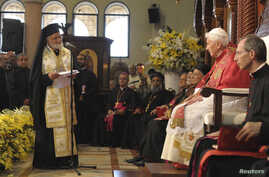Pope Benedict XVI (2nd R) listens as Gregorios III, Patriarch of the Church of Antioch, speaks at the St. Paul Basilica in Harissa near Beirut, September 14, 2012.