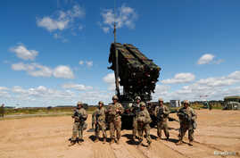 U.S. soldiers stand next to a Patriot missle system during Toburq Legacy 2017, an air defense exercise, in a military airfield near Siauliai, Lithuania, July 20, 2017.