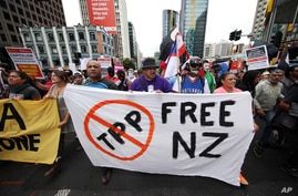 Protesters march to the venue of the Trans-Pacific Partnership signing in Auckland, New Zealand, Feb 4, 2016.